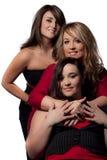 Trois jeunes dames rectifiées par bien Photos stock