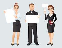 Trois jeunes employés heureux tenant trois affiches avec l'espace pour votre texte ou produit Image stock