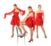 Trois jeunes filles blondes dans la robe rouge, collage Images stock