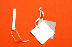Trois labels différents sur le fond orange Photos libres de droits