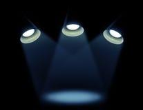 Trois lampes sur un fond noir Photos stock