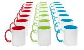 Trois lignes des tasses colorées Photo libre de droits