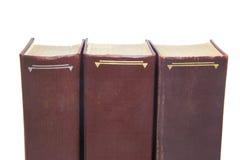 Trois livres bruns d'isolement sur le fond blanc photographie stock libre de droits