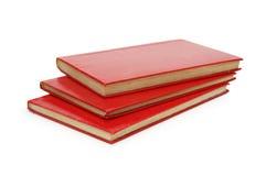 Trois livres rouges ont isolé Photographie stock libre de droits