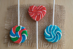 Trois lucettes colorées de sucre Image stock