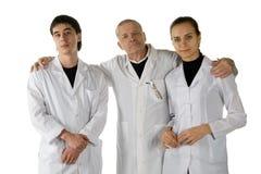 Trois médecins. Photo libre de droits
