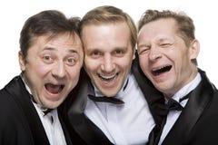 Trois messieurs images libres de droits