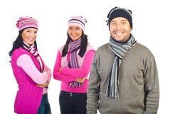Trois modèles heureux dans des vêtements de l'hiver Photographie stock libre de droits