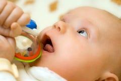 Trois mois infantiles. Photographie stock libre de droits