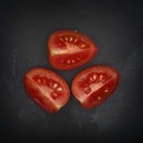 Trois moitiés de tomate-cerise Photographie stock