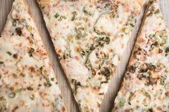 Trois morceaux de pizza Photos libres de droits