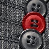 Trois noirs et boutons rouges Image libre de droits