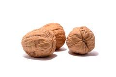 Trois noix avec l'ombre Photos stock