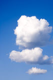 Trois nuages pelucheux photos stock