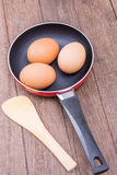 Trois oeufs dans la casserole Photographie stock libre de droits