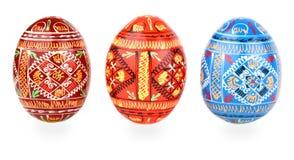 Trois oeufs de pâques russes de tradition côte à côte au-dessus de W Photos libres de droits
