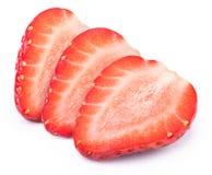 Trois ont coupé en tranches des fraises d'isolement Image libre de droits