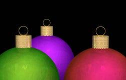 Trois ornements de Noël Photographie stock libre de droits