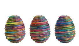 Trois Pâques-oeufs sur le blanc Images libres de droits