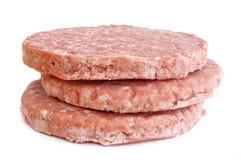Trois pâtés surgelés d'hamburger Image stock