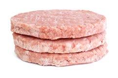Trois pâtés surgelés d'hamburger Photo libre de droits