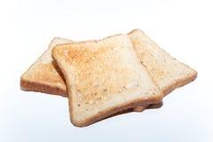 Trois pains des pains grillés sur le blanc d'isolement Photos libres de droits