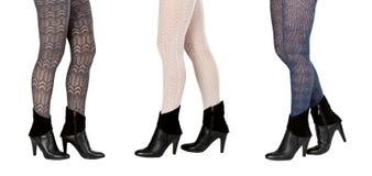 Trois paires de pattes femelles dans le pantyhose Images libres de droits