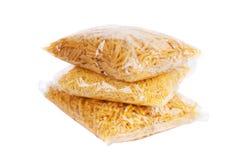 Trois paquets de macaronis Photographie stock libre de droits
