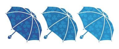 Trois parapluies bleus Photo libre de droits