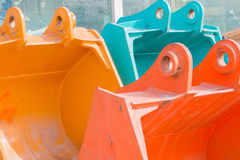 Trois pelles colorées à excavatrice Photo libre de droits