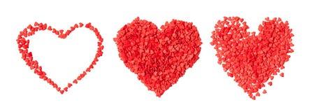 Trois petits coeurs rouges de coeurs d'isolement Photo libre de droits