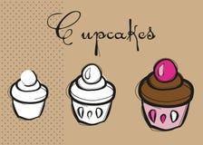 Trois petits gâteaux délicieux délicieux Photographie stock libre de droits