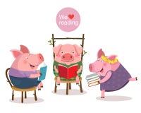 Trois petits porcs lisant un livre Image libre de droits