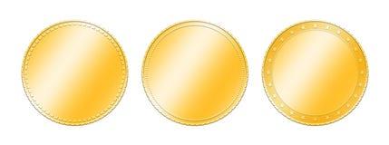 Trois pièces d'or différentes au-dessus de blanc Images libres de droits