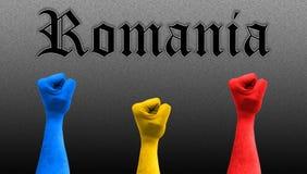 Trois poings dans le ciel avec des couleurs roumaines de drapeau image stock