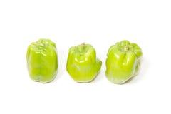 Trois poivrons verts sur le blanc d'isolement Image stock