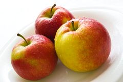 Trois pommes Photographie stock libre de droits
