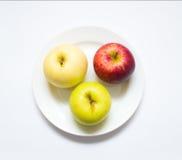 Trois pommes colorées Image libre de droits