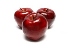 Trois pommes rouges Photographie stock libre de droits