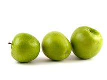 Trois pommes vertes Photos libres de droits