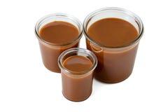 Trois pots de caramel salé Photo stock