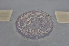 trois poulpes sur la couverture de trou d'homme de Hakodate Photographie stock