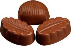 Trois pralines de chocolats - d'isolement image stock
