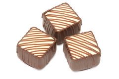 Trois pralines rayées de chocolat photographie stock