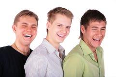 Trois rires d'amis Photographie stock