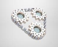 Trois roues dentées enchaînées ensemble Photographie stock