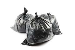 Trois sacs de déchets noirs photo stock