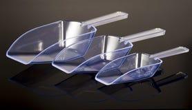 Trois scoops transparents en plastique photos stock