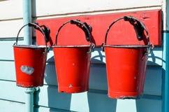 Trois seaux rouges Photos libres de droits