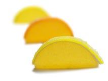 Trois segments de gelée de citron d'isolement Image libre de droits
